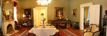 Back parlor with piano at Historic Oakleigh Museum House. Mobile, AL.