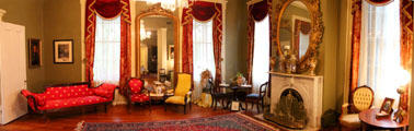 Parlor with sofa & chairs at Historic Oakleigh Museum House. Mobile, AL.