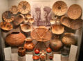 Collection of Akimel O'odham native baskets, wooden bowls & ceramic jars at Arizona State Museum. Tucson, AZ.