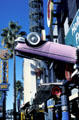 Fantasy world of pink convertibles embedded in freeway sign at Universal Studios CityWalk. Universal City, CA.