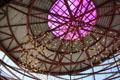 California Science Center atrium with celestial bodies suspended from metal lattice. Los Angeles, CA