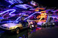 Neon artwork over DeLorean DMC12 & Mercedes Benz McLaren SLR at Petersen Automotive Museum. Los Angeles, CA.