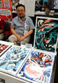 Artist Michael Cho with his comic prints at Comic-Con International. San Diego, CA.