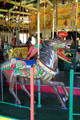 Carved horse with Arabian motif on Balboa Park Carousel. San Diego, CA.