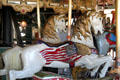 Carved horse with American flag on Balboa Park Carousel. San Diego, CA.