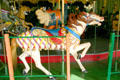 Carved horse with fancy saddle on Balboa Park Carousel. San Diego, CA.