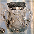 Cut glass base with silver rim & three handles at Historical Glass Museum. Redlands, CA.