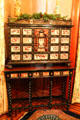 Cabinet with inlaid drawers on table with stretchers at Kimberly Crest House. Redlands, CA.