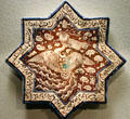Iran: star shaped tile with phoenix prob. From Sultanabad in Asian Art Museum. San Francisco, CA.
