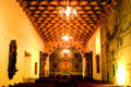 Chapel interior with wooden beams painted in vegetable dyes by Ohlone Indians in Mission Dolores. San Francisco, CA.