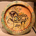 Earthenware disk with horse & cheetah from Eastern Iran at Asian Art Museum. San Francisco, CA.
