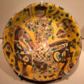 Earthenware bowl with horse & rider from Eastern Iran at Asian Art Museum. San Francisco, CA.
