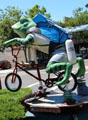 Sculpture of Jumping Frog riding a bicycle. Angels Camp, CA.
