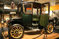 Side view with open door of 100-mile Fritchle Electrics automobile at Colorado History Museum. Denver, CO.
