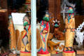 Hand carved Hopi Kachina dolls in shop window on Greene St. Silverton, CO.