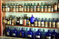 Antique medicine bottles in J.A. Merriam Drug Store at South Park City. Fairplay, CO