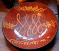 Redware plate at Henry Whitfield State Museum. Guilford, CT.