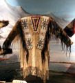 Lakota fringed leather shirt with beadwork at National Museum of the American Indian. Washington, DC.