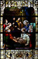 Stained glass window of St. Augustine healing a sick man in Cathedral. St Augustine, FL.