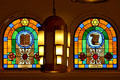 Jewish symbols on stained-glass windows flank Art Deco lamp in Jewish Museum of Florida. Miami Beach, FL.