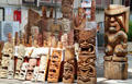 Hawaiian tikis & masks in wood carver shop at International Market Place. Waikiki, HI.