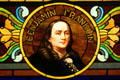 Details of stained glass window of Printers History showing Benjamin Franklin at Stained Glass Museum. Chicago, IL.