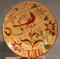 Redware plate painted with bird in tree from Southeastern PA at Art Institute of Chicago. Chicago, IL.