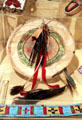 Plains Indian rawhide painted shield with feathers & buffalo tail at Sedgwick County Historical Museum. Wichita, KS.