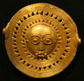 Akan peoples gold sun mask from Ashanti Kingdom, Ghana, at New Orleans Museum of Art. New Orleans, LA.