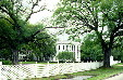 Nottaway Plantation seen under oaks. White Castle, LA.
