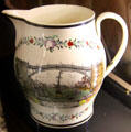Creamware pottery jug with view of Iron Bridge at Sunderland, England at New Bedford Whaling Museum. New Bedford, MA.