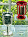 Silvered glass engraved goblet and spill holder at Sandwich Glass Museum. Sandwich, MA.