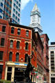 Batterymarch St. heritage streetscape with red corner building & Custom House Tower. Boston, MA.