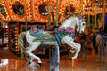 Flower decked white stallion on carousel in Mall of America. Minneapolis, MN.