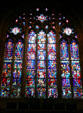 Stained-glass windows over alter of Princeton University Chapel. Princeton, NJ.