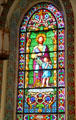 Evangelist St. Mathew with angel stained glass window in St. Francis Cathedral. Santa Fe, NM.
