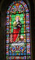Evangelist St. Mark with lion stained glass window in St. Francis Cathedral. Santa Fe, NM.