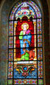 Evangelist St. Luke with bull stained glass window in St. Francis Cathedral. Santa Fe, NM.