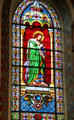 Evangelist St. John with eagle stained glass window in St. Francis Cathedral. Santa Fe, NM.