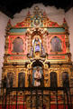 La Conquistadora Chapel with Our Lady of the Rosary on reredos with saints in St. Francis Cathedral. Santa Fe, NM.