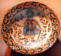 Spanish bowl with painted soldier at New Mexico History Museum. Santa Fe, NM.