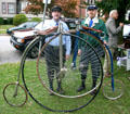 Penny-farthing bicyclists at Art on Wheels Fair. Buffalo, NY.