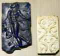Roman glass plaques of Satyr & foliage at Corning Museum of Glass. Corning, NY.