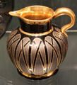 Gilded black Hyalith glass jug by glassworks of count of Buquoy of Southern Bohemia at Corning Museum of Glass. Corning, NY.