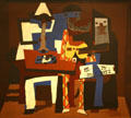 Three Musicians painting in cubist style by Pablo Picasso at MoMA. New York, NY.
