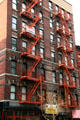 Heritage building with orange fire escapes. New York, NY.