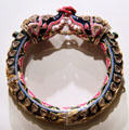 Bangle with elephant finials from Benares, India at Brooklyn Museum. Brooklyn, NY.