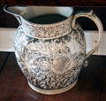 Lusterware pitcher with detailed floral design in white on silver at Home Sweet Home Museum. East Hampton, NY.