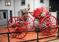"Firefighting four-wheeled ""spider"" hose cart at carriage collection of Long Island Museum. Stony Brook, NY."