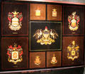 Heraldic paintings of American patriots for coaches by Peter Barry of Brewster & Co. were displayed at Paris Exposition Universelle at carriage collection of Long Island Museum. Stony Brook, NY.